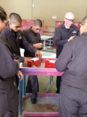 Students working in an auto shop