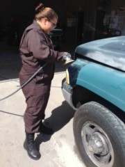 Student prepping a vehicle to paint